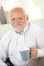 Smiling old man having coffee portrait of looking happy Royalty Free Stock Photography