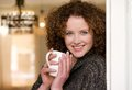 Smiling older woman holding cup of tea close up portrait a at home Stock Photo