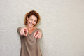 Smiling older woman pointing fingers Royalty Free Stock Photo