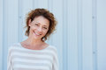 Smiling older woman standing outside Royalty Free Stock Photo
