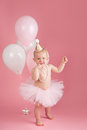 Smiling One Year Old Birthday Girl Wearing a Pink Tutu Royalty Free Stock Photo
