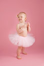 Smiling One Year Old Girl Wearing a Pink Tutu Royalty Free Stock Photo