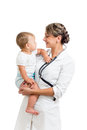 Smiling paediatrician doctor holding baby on hands Royalty Free Stock Images