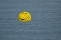 Smiling parasail chute with big happy smile above the sea Stock Image
