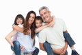 Smiling parents holding their children on backs white background Stock Photo