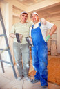 Smiling plasterers Royalty Free Stock Photo