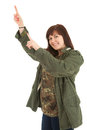 Smiling pointong up teenage girl in militry jacket Royalty Free Stock Photography
