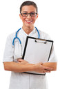 Smiling positive woman doctor with blank clipboard Royalty Free Stock Image