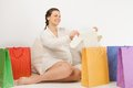 Smiling pregnant woman opening shopping bag Royalty Free Stock Photo