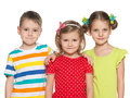 Smiling preschoolers three on the white background Royalty Free Stock Photography