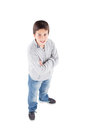 Smiling preteen boy seen from above standing isolated on a white background Stock Photography