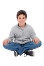 Smiling preteen boy sitting on the floor isolated a white background Stock Photography