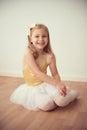 Smiling pretty ballet girl in white tutu in studio Royalty Free Stock Photo