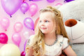 Smiling pretty blonde girl posing in playroom image of Royalty Free Stock Photos