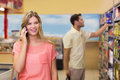 Smiling pretty blonde woman phoning Royalty Free Stock Photo