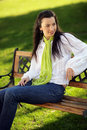 Smiling pretty girl sitting on a bench Royalty Free Stock Photography