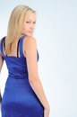 Smiling pretty woman in a blue dress Royalty Free Stock Images