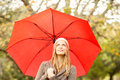 Smiling pretty woman under umbrella on an autumns day Stock Images