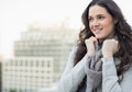 Smiling pretty woman in winter clothes posing outside on a cloudy day Stock Images