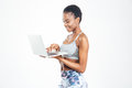 Smiling pretty young african american sportswoman using laptop Royalty Free Stock Photo
