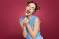Smiling pretty young woman holding lollipop and singing Royalty Free Stock Photo