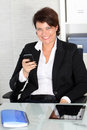 Smiling profile shot of a business woman. Royalty Free Stock Photography