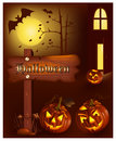 Smiling pumpkins with bats and moon. Royalty Free Stock Image