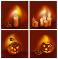Smiling pumpkins and burning candles. Stock Images