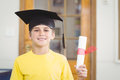 Smiling pupil with mortar board and diploma Royalty Free Stock Photo