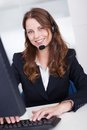 Smiling receptionist or call centre worker Royalty Free Stock Image
