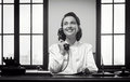 Smiling receptionist at work Royalty Free Stock Photo