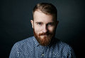Smiling red bearded man studio portrait on dark background Royalty Free Stock Photo