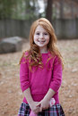 Smiling redhead girl with missing teeth Stock Image