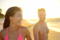 Smiling romantic young couple in beach sunset joyful mixed race on enjoying summer vacation holiday travel beautiful asian woman Royalty Free Stock Images