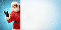 Smiling Santa Claus holding banner with  blank space for Your Text Royalty Free Stock Photo