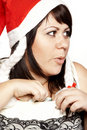 Smiling santa girl hiding dollars Stock Images