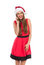Smiling santa girl on the phone Royalty Free Stock Photo