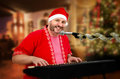 Smiling Santa singing Christmas songs Royalty Free Stock Photo