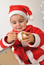 Smiling Santa toddler girl Stock Image