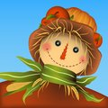 Smiling scarecrow. Apples and pumpkin on the hat top. Corn leaves scarf with straw. Vector illustration.