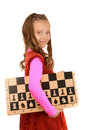 Smiling schoolgirl with chess board portrait of beautiful curly hair and isolated on white background Royalty Free Stock Image