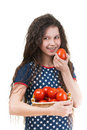 Smiling schoolgirl holds basket of tomato Royalty Free Stock Photo