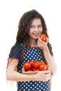 Smiling schoolgirl holds basket of tomato Royalty Free Stock Photo