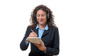 Smiling secretary or receptionist taking notes friendly wearing a headset on a handheld notepad upper body isolated on white Royalty Free Stock Photos