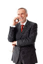 Smiling senior business man phoning isolated on white background Royalty Free Stock Photo