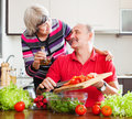 Smiling senior couple cooking together in home kitchen Royalty Free Stock Photography