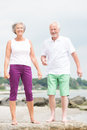 Smiling senior couple happy and at the beach Stock Image