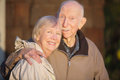 Smiling senior couple outdoors cute embracing each other Stock Photo