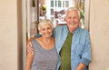 Smiling senior couple welcoming at their front door Royalty Free Stock Photo