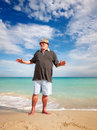 Smiling senior man casual doing exercise on beach Stock Image